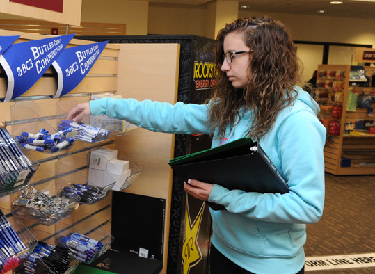 A student looking at items in the bookstore