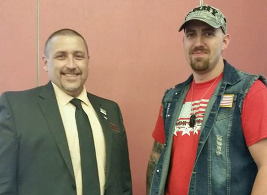 Butler County Commissioner stands with a BC3 Veteran student.