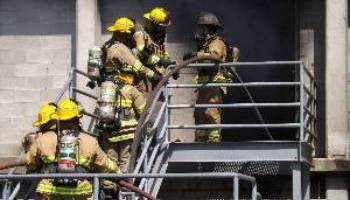 fire fighters on stairs at training facility