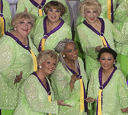 members of the chorus in green costumes