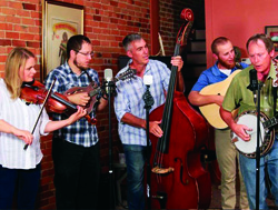 The members of Well Strung Bluegrass Band practicing